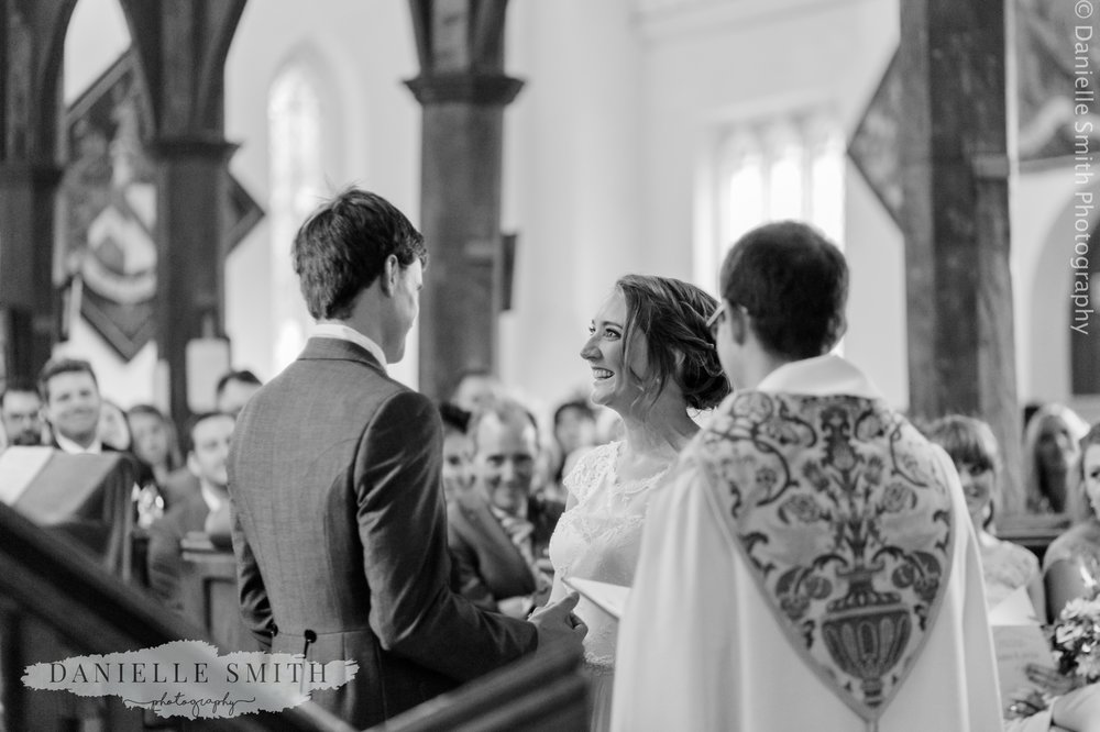 bride and groom laughing during wedding vows