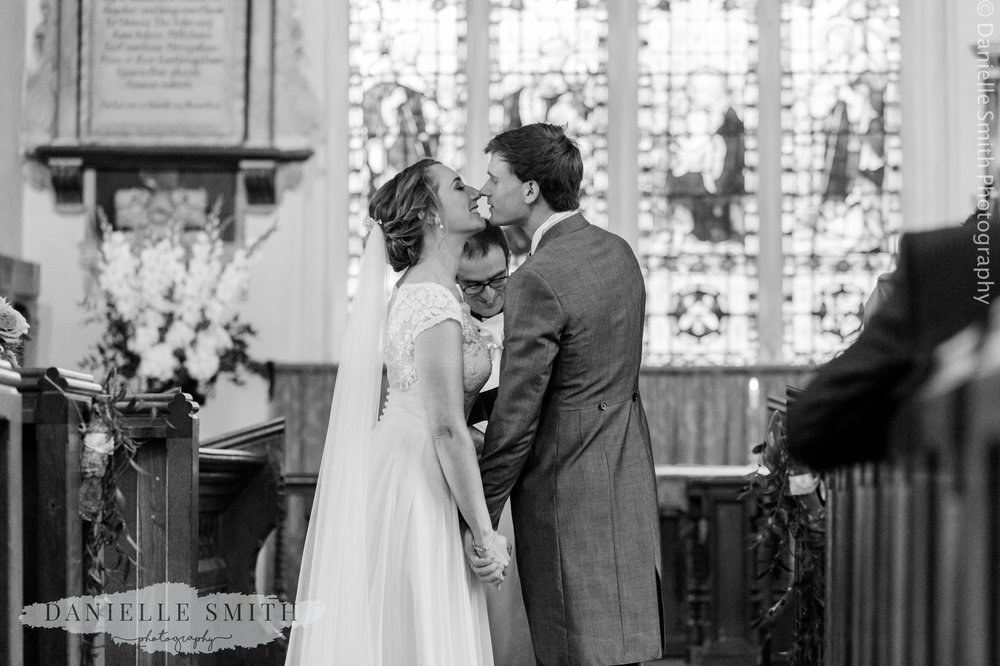 ride and grooms first kiss in church