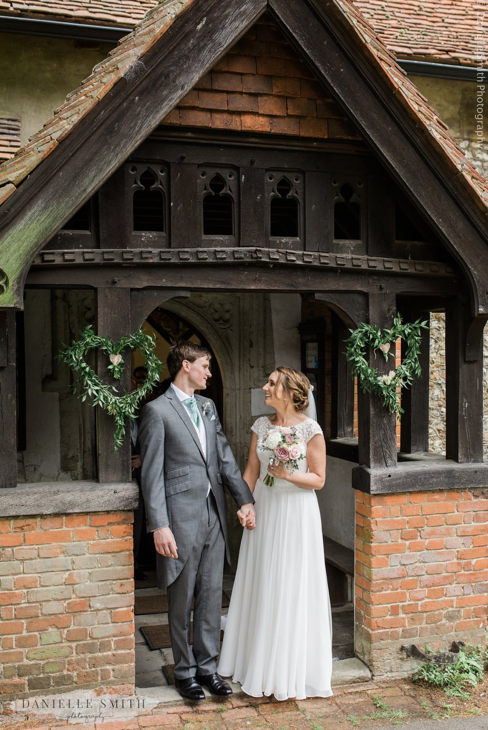 bride and groom outside church after wedding