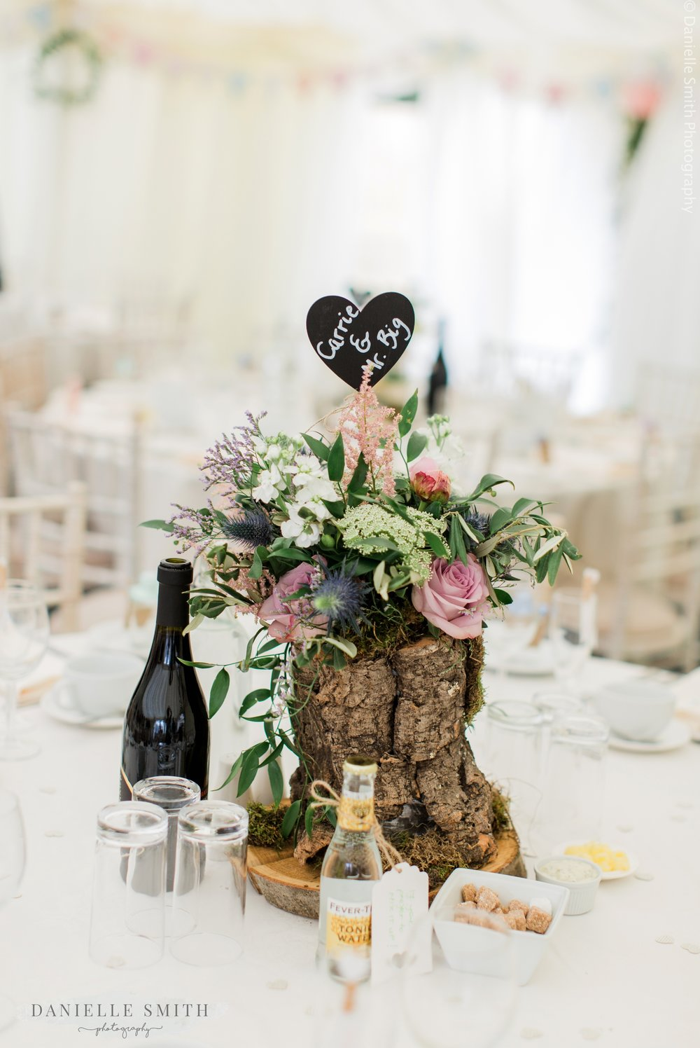tree trunk centre piece with flowers