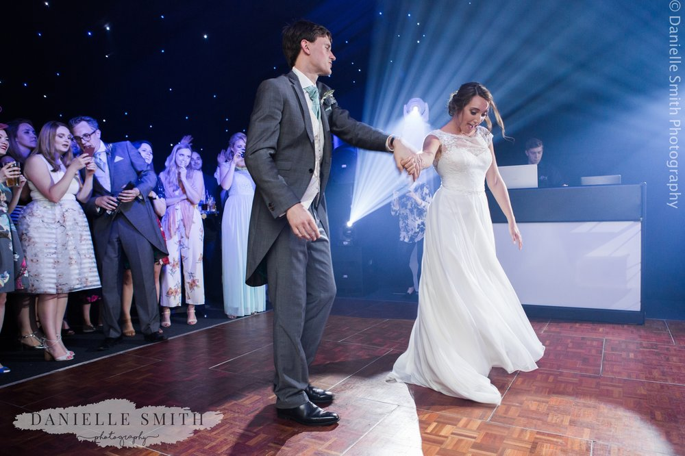 bride and grooms first dance - relaxed marquee wedding