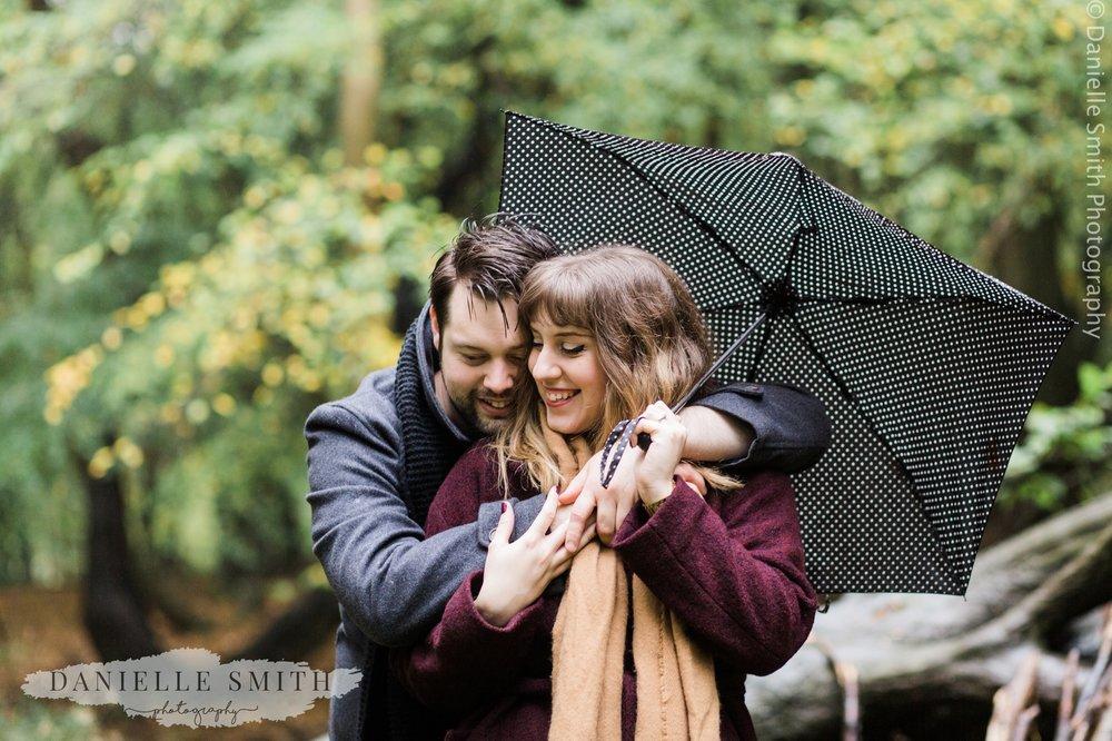couple hugging in rain