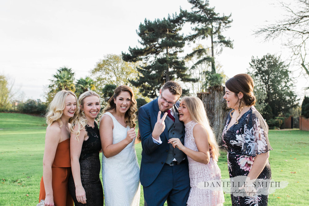 bridal party photo with groom swearing