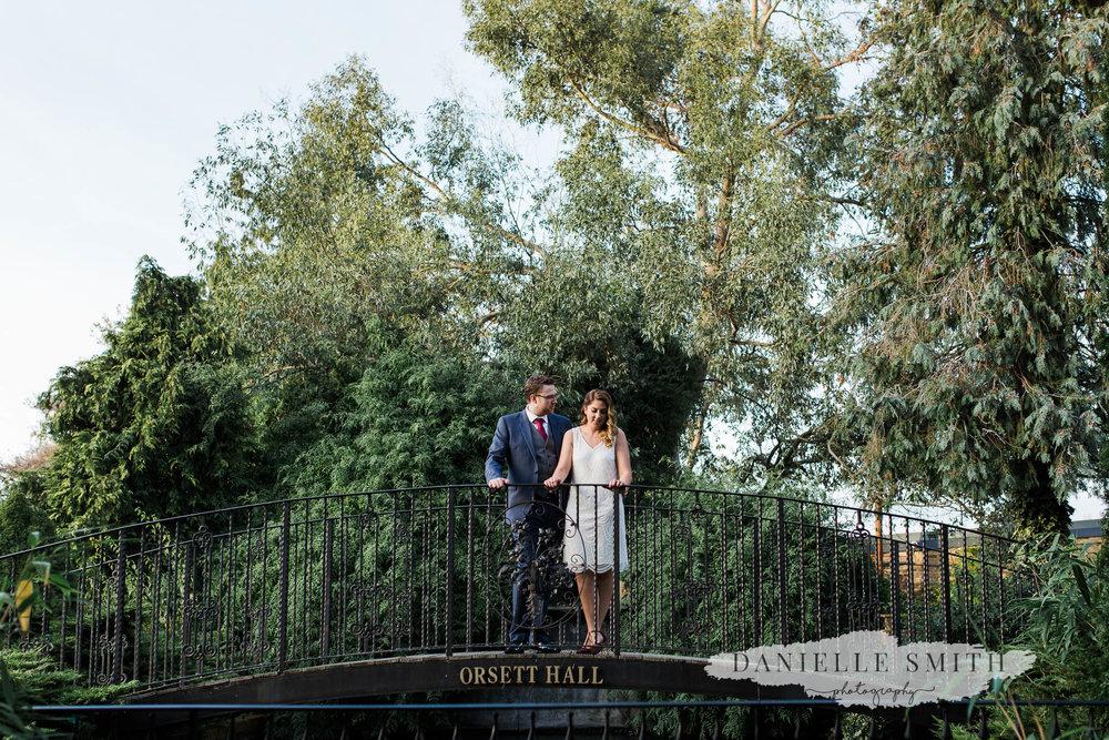 couple portrait on bridge at orsett hall