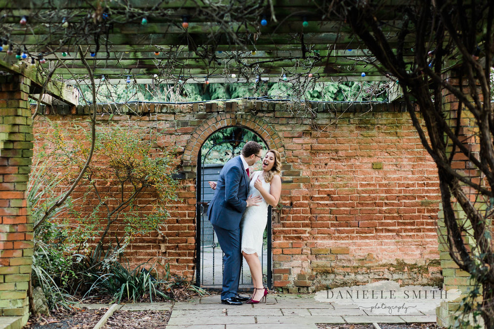 bride and groom laughing so much - orsett hall wedding photography
