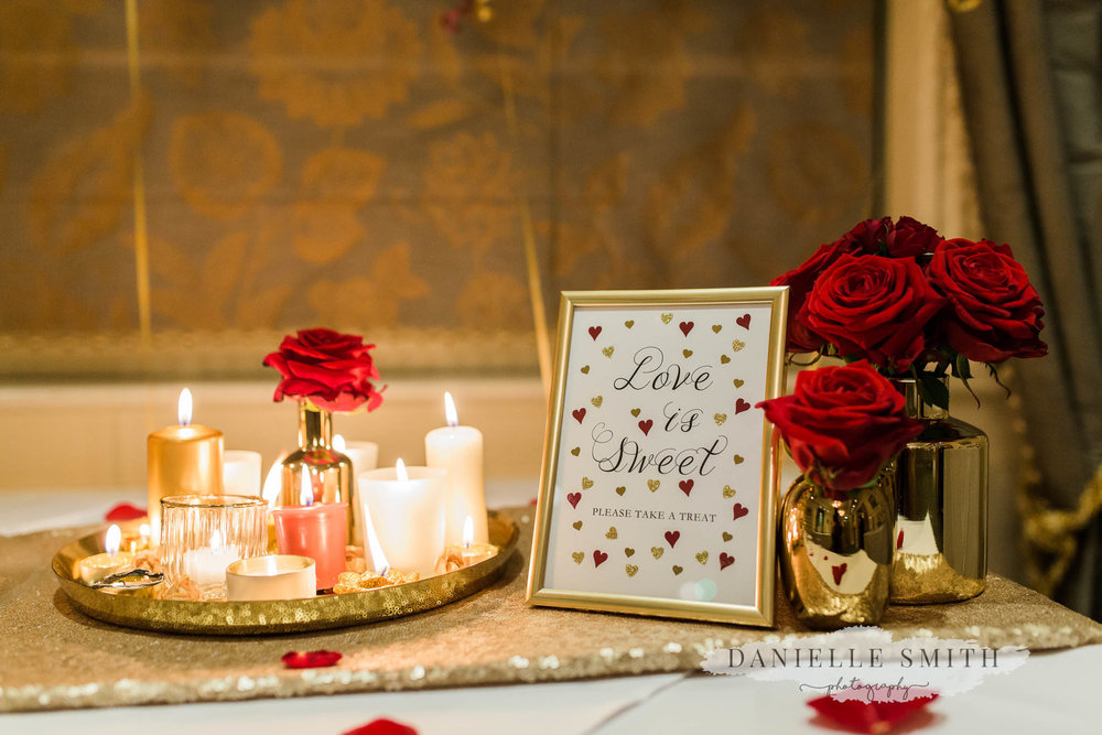red roses and gold details at wedding