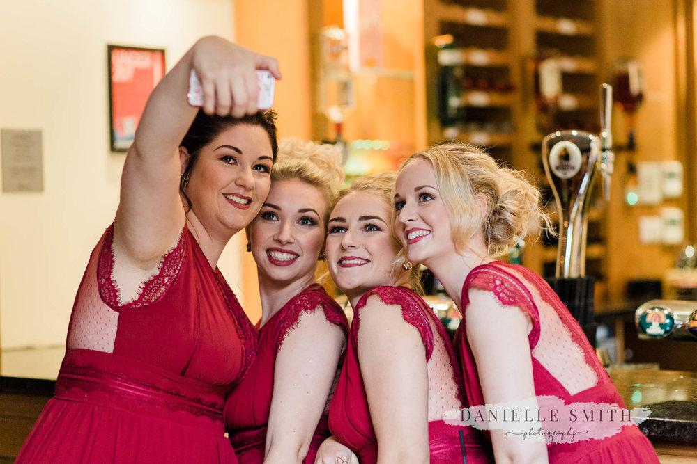 bridesmaids having selfie
