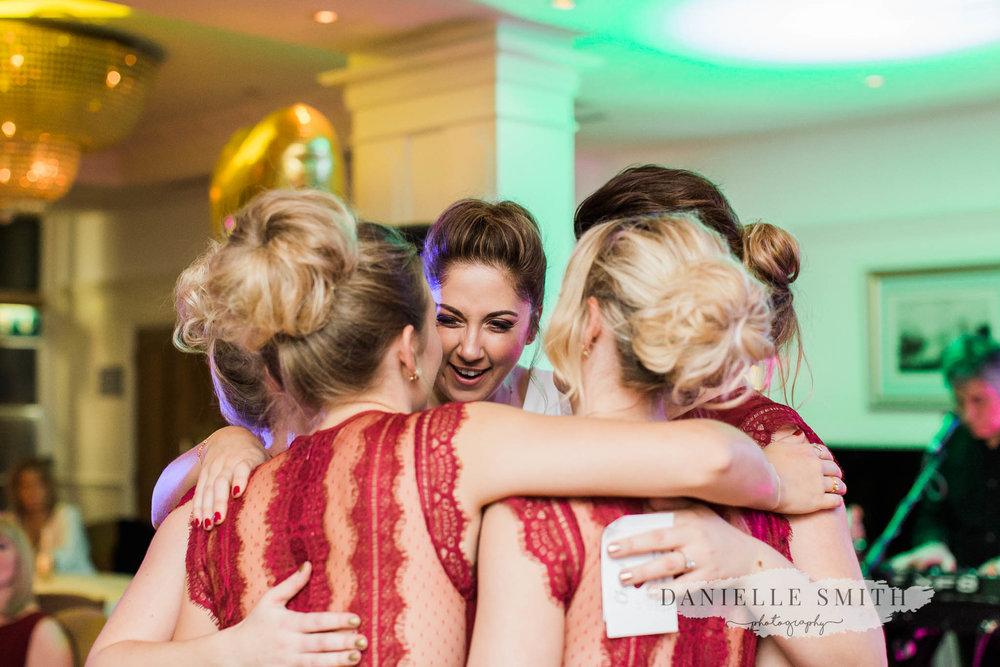 bridesmaids group hug - orsett hall wedding