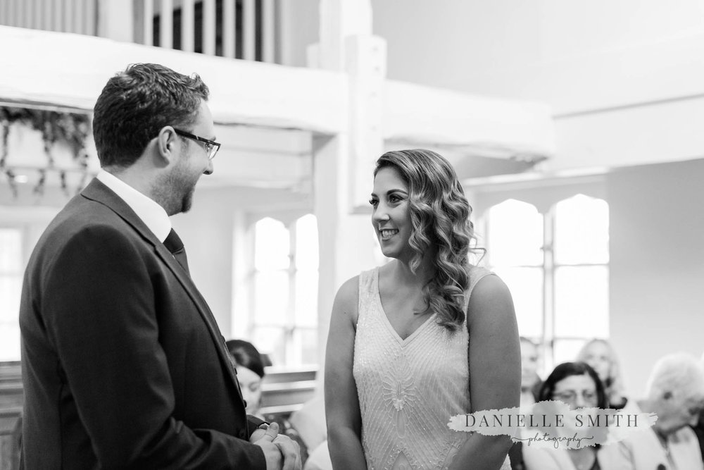 bride and groom during ceremony at orsett hall