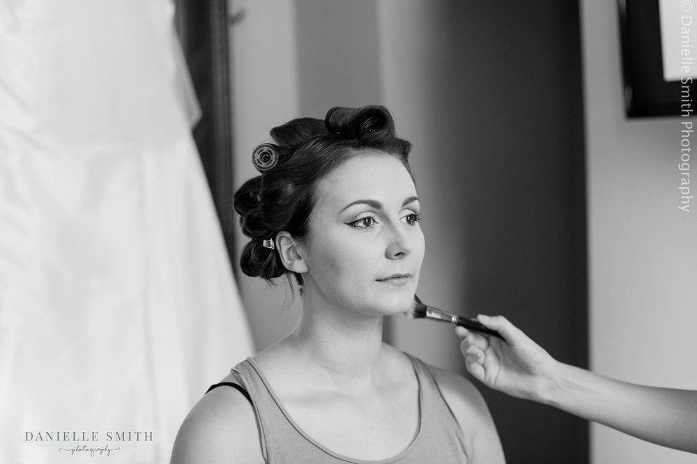 bridesmaid having her make up done