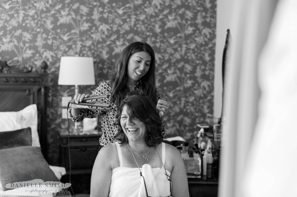 mother of the bride having her hair done