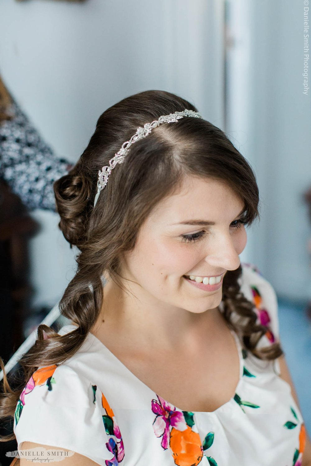 bride having her hair finished for wedding