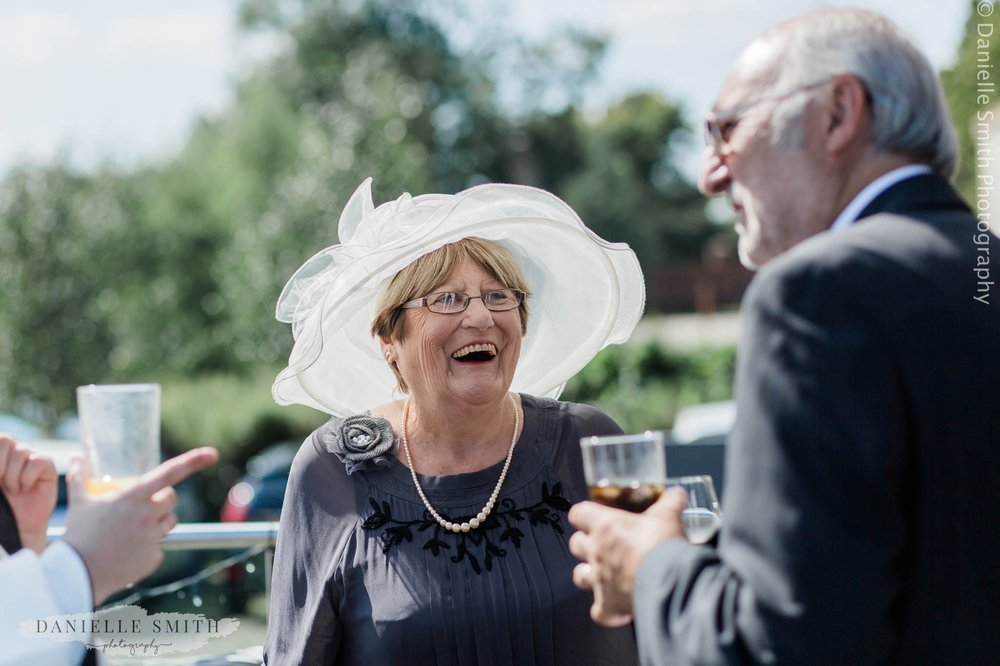 guest laughing at outdoor wedding