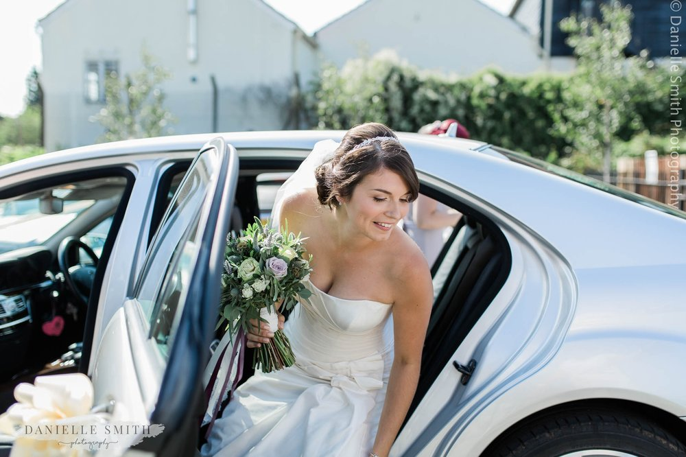 bride getting out of car at west street vineyard