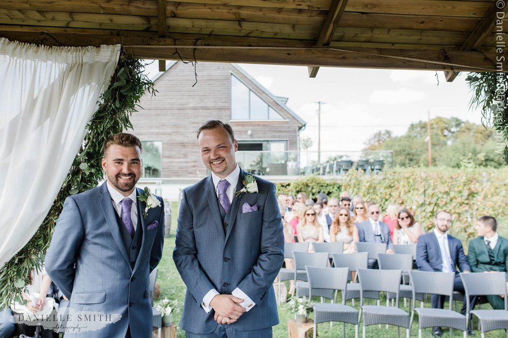 groom and best man waiting for bride to walk down aisle
