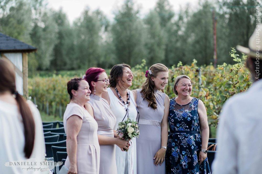 family laughing at vineyard wedding