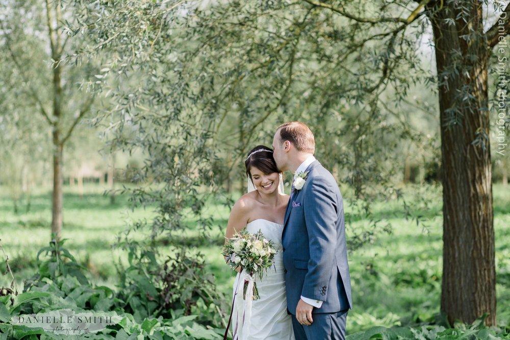 bride and groom at vineyard - wedding photography essex