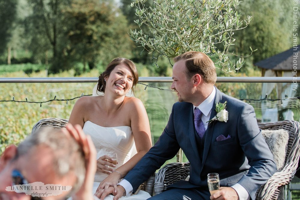 bride and groom laughing at speeches - essex wedding photography