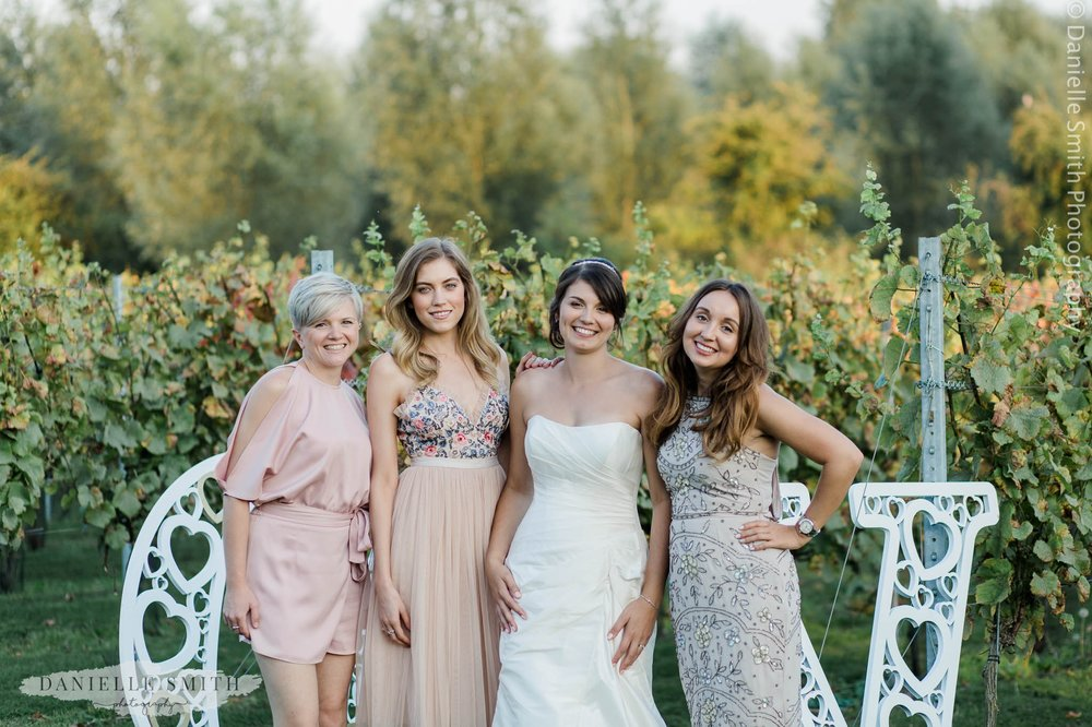 bride and friends at her vineyard wedding