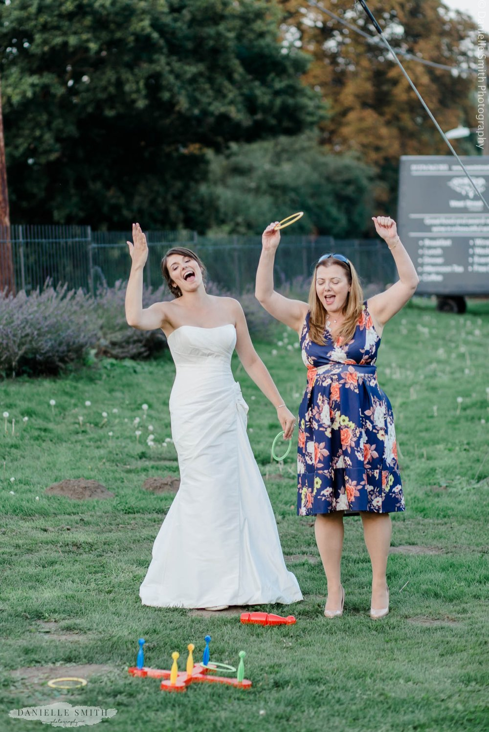 bride and friend playing garden games
