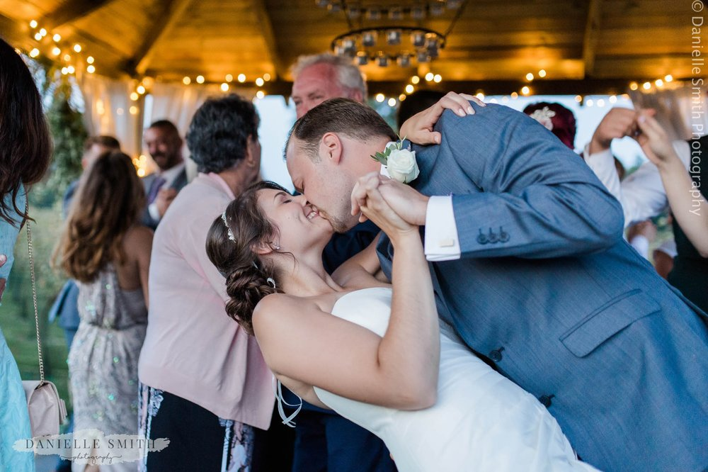 bride and groom kissing at end of first dance