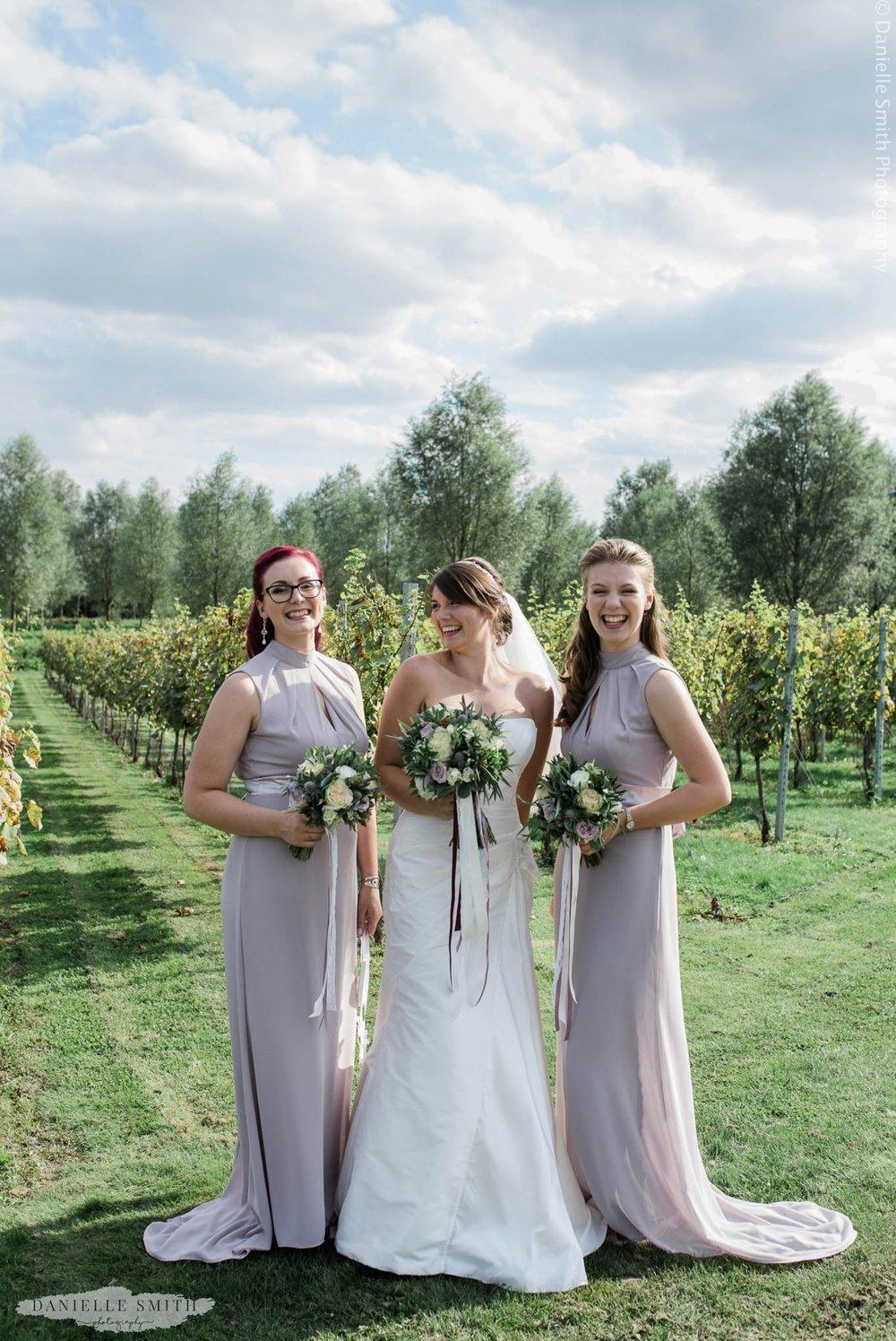 bride and 2 bridesmaids at west street vineyard wedding