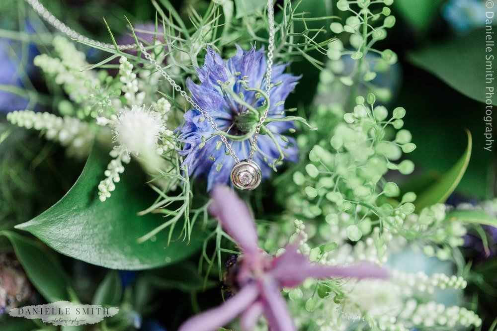 necklace on wedding bouquet