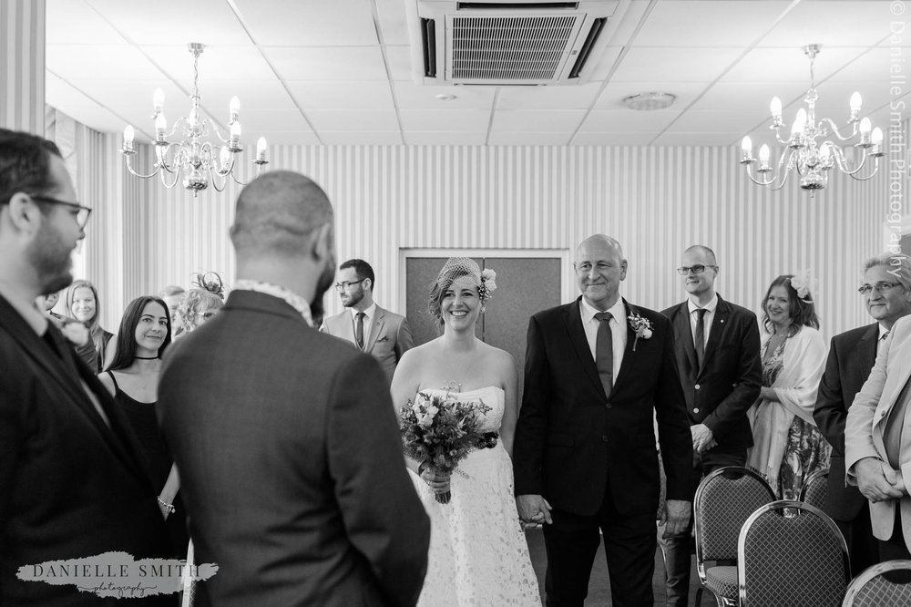 bride walking down the aisle seeing groom for first time
