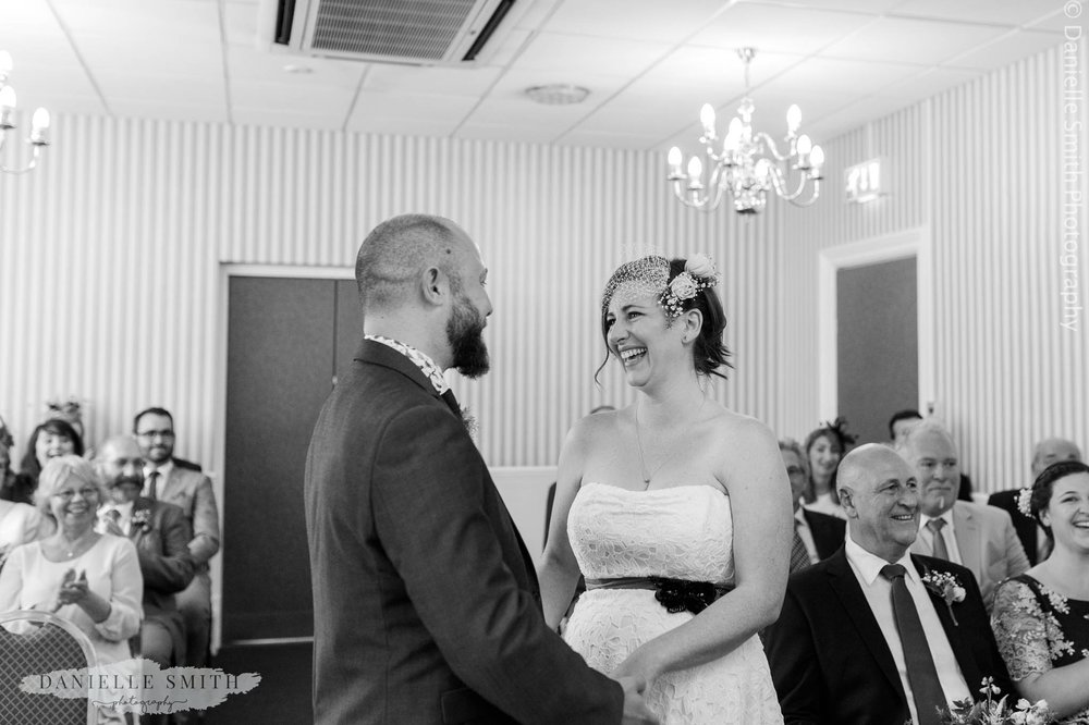 bride and groom smiling - relaxed and fun wedding