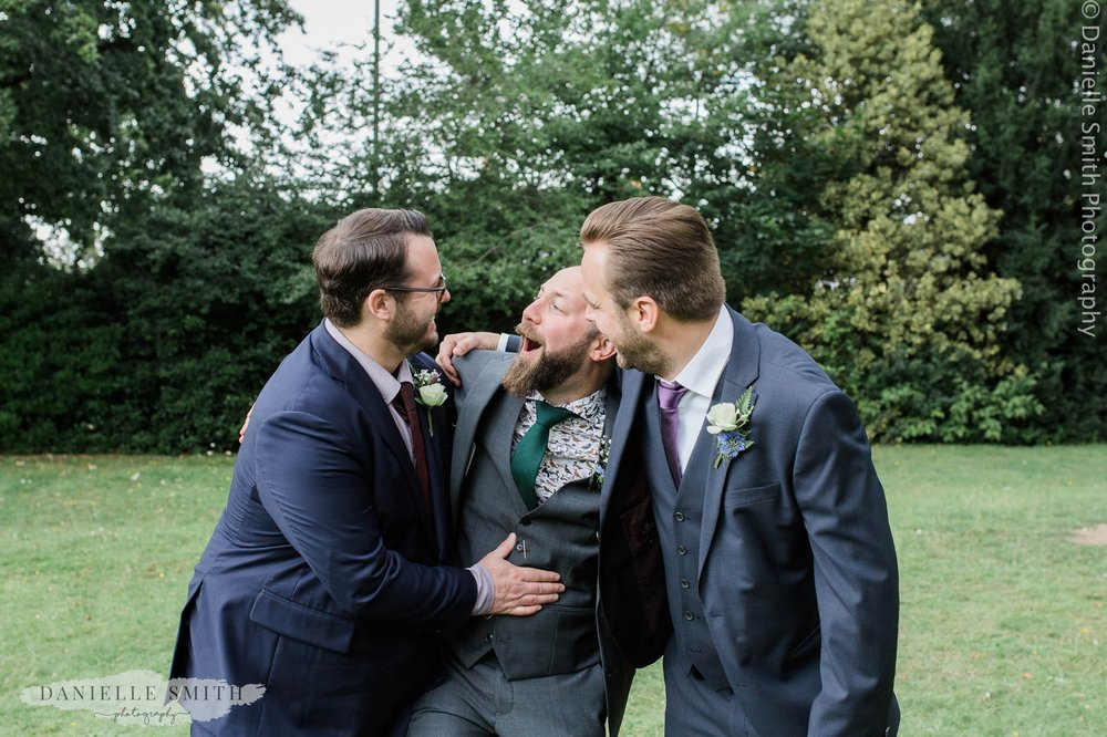 groom being silly with 2 best men