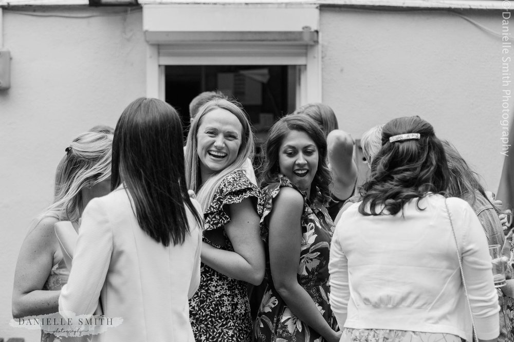 girls having fun at wedding - bowls club wedding