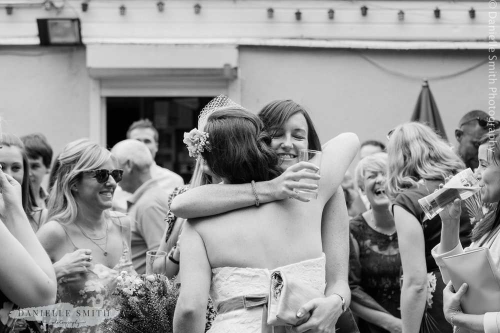 bride hugging her friend - bowls club wedding