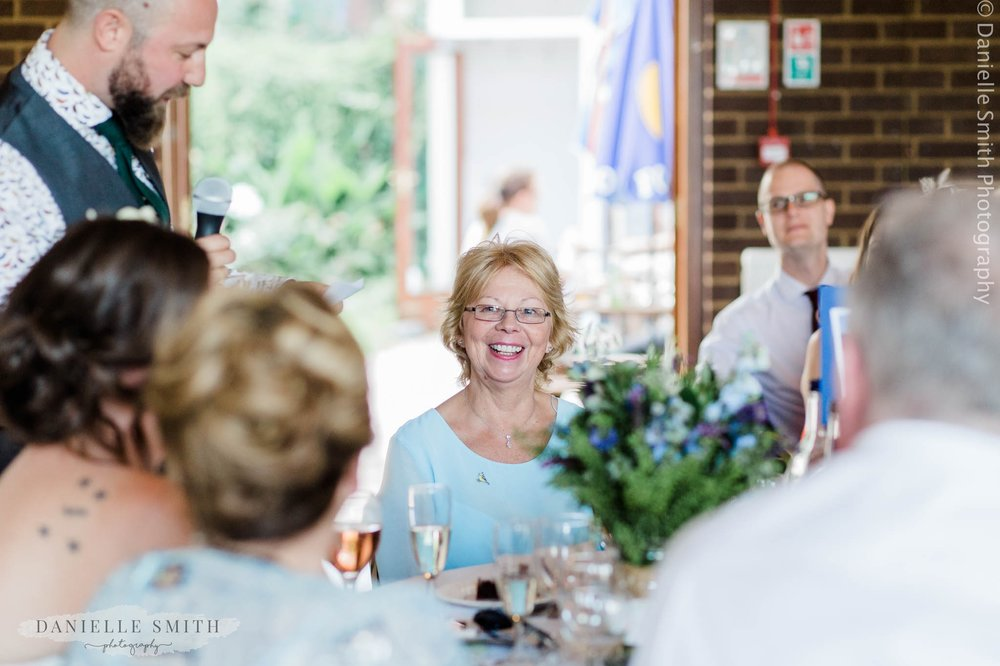 mother of the groom smiling