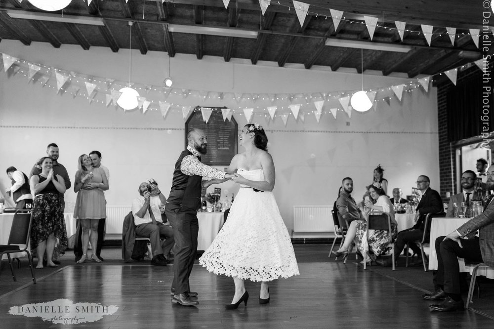 bride and groom first dance at bowls club