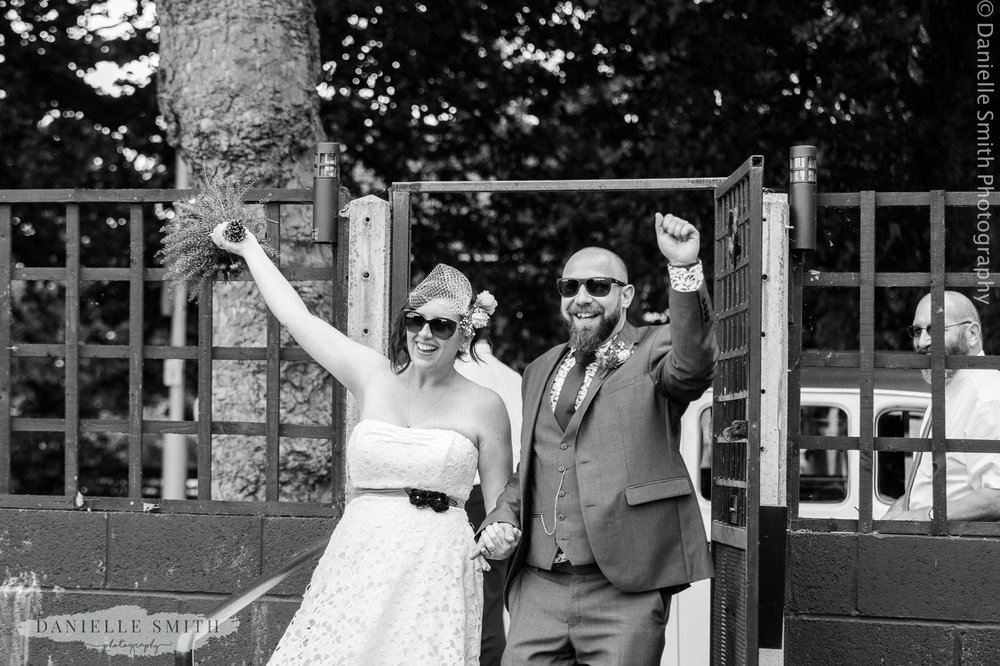 bride and groom cheering when they enter wedding