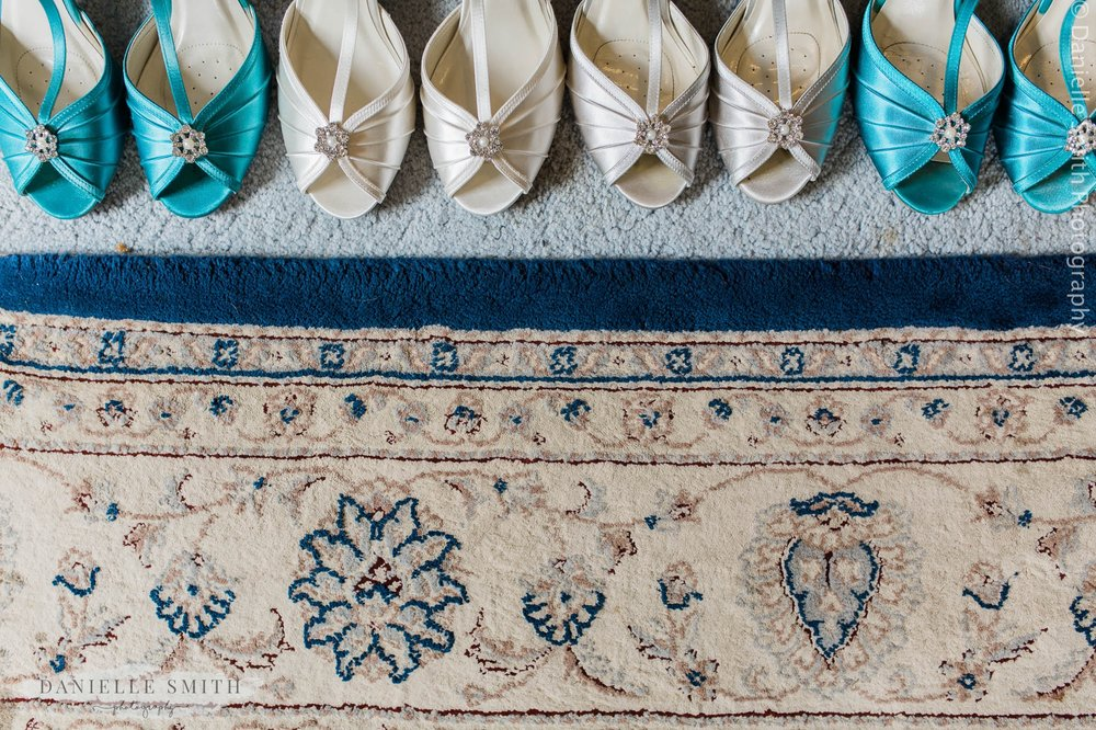 teal and ivory bridesmaid shoes lined up