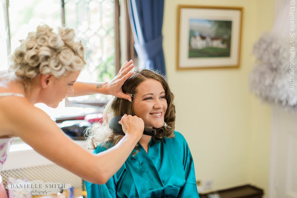 bridesmaid having her hair done at mangapp manor