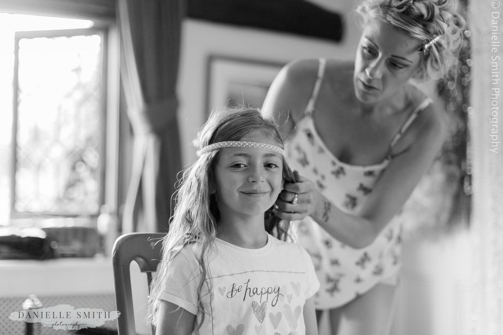 flower girl having her hair done