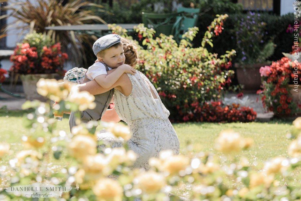 bride cuddling her son