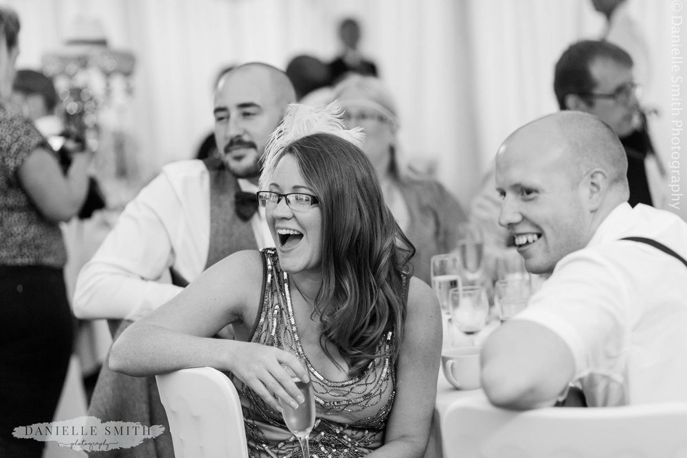 bridesmaid laughing during reception