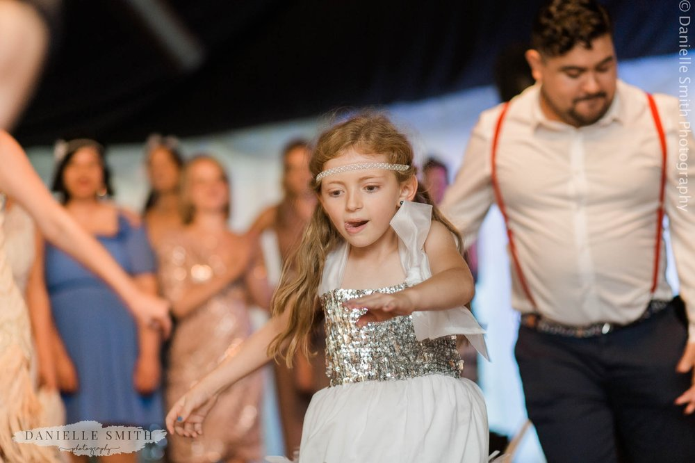 flower girl dancing at wedding