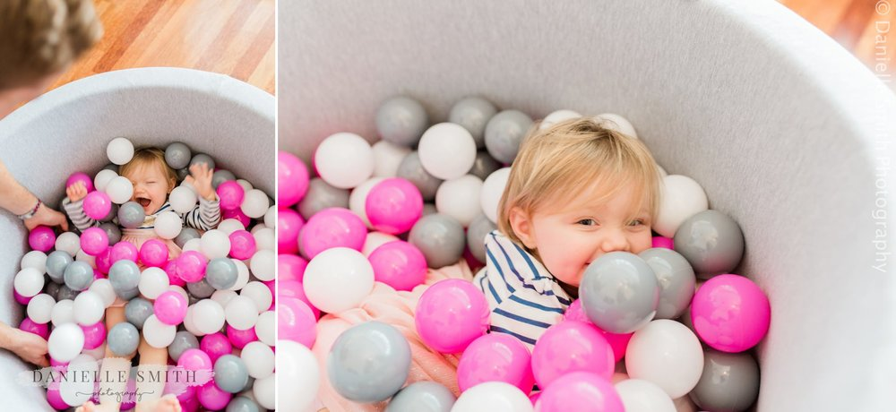 little girl having fun on her first birthday photo shoot