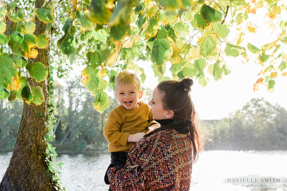 son laughing with his mum during photo shoot