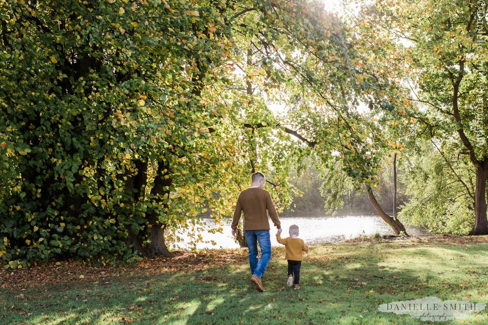 father and son walking in the park