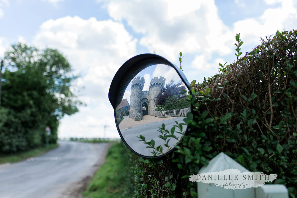 reflection of cooling castle barn in mirror