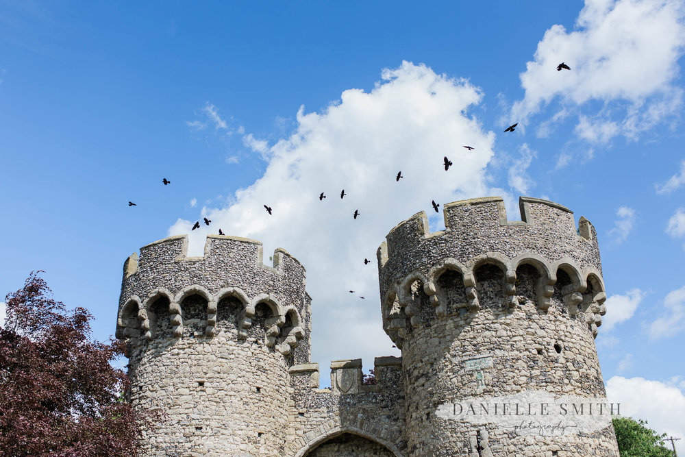 birds flying over cooling castle barn turrets