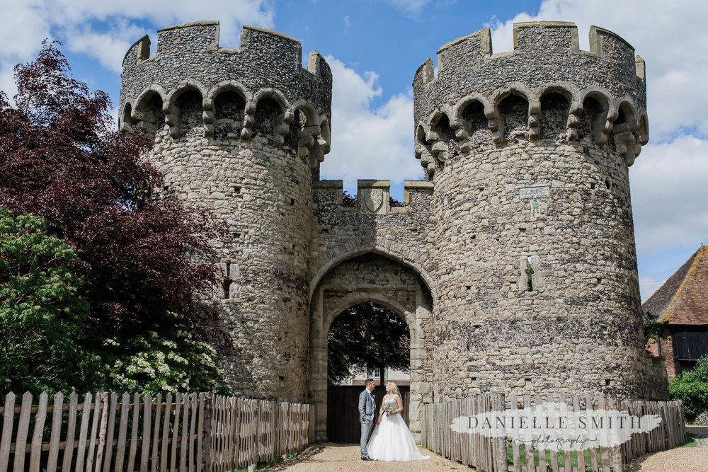 castle exterior and bride and groom