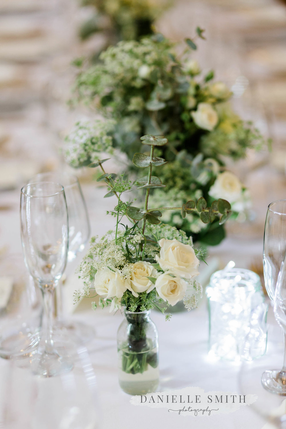white roses on table at wedding