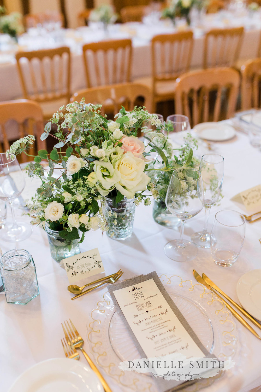 pastel flowers and gold touches on wedding decor