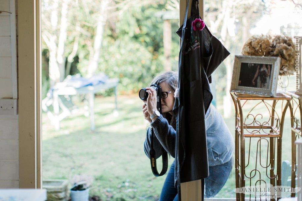 florist taking photos in her workshop